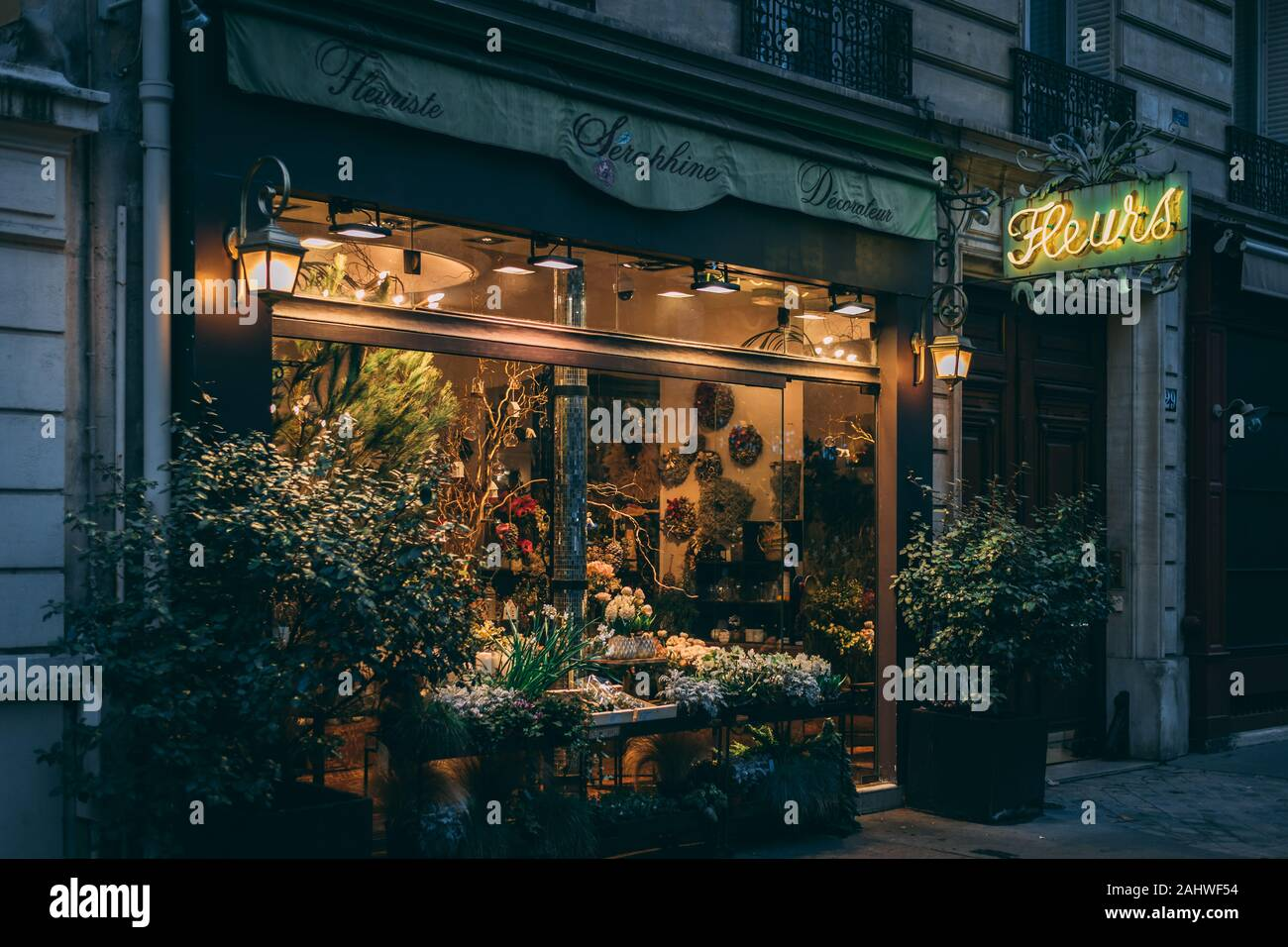 A flower shop with neon sign in Paris, France Stock Photo