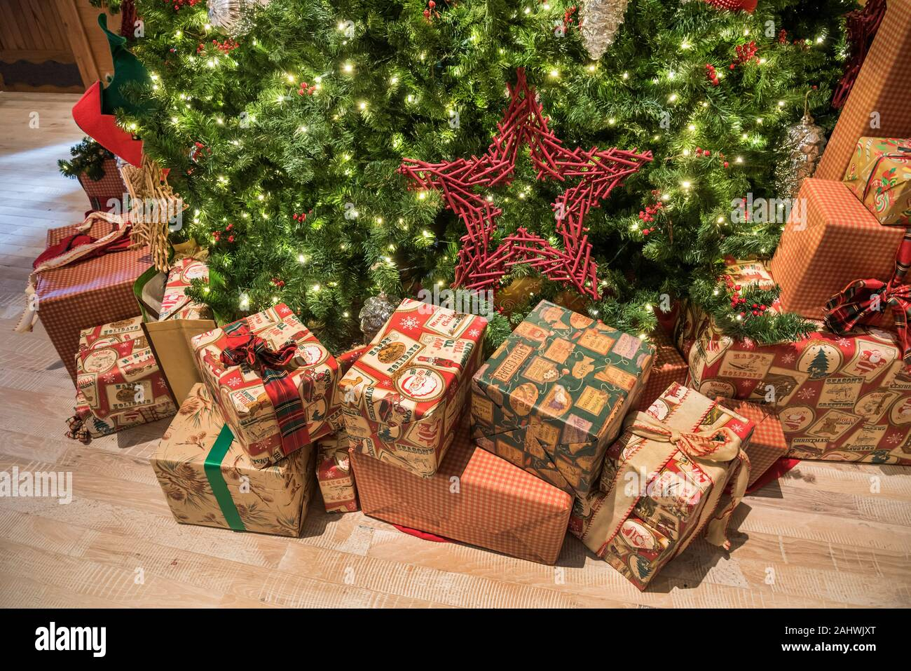 Christmas Decorations And Gifts Under A Large Christmas Tree Stock Photo Alamy