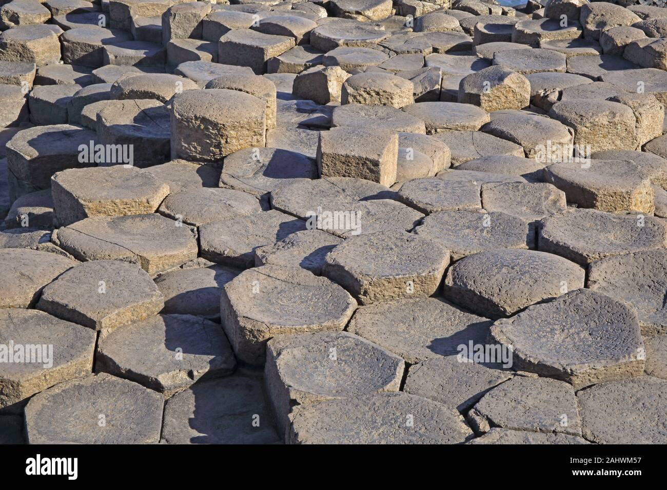 Basalt pavement created by tops of the massive basalt columns of the Giant's Causeway, County Antrim, Northern Ireland, UK. Stock Photo