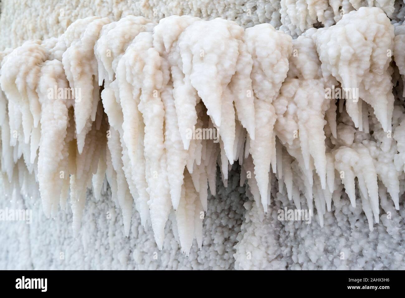 Salt stalactites forming on the Dead Sea coast.  The Sea has the lowest elevation on earth. Stock Photo