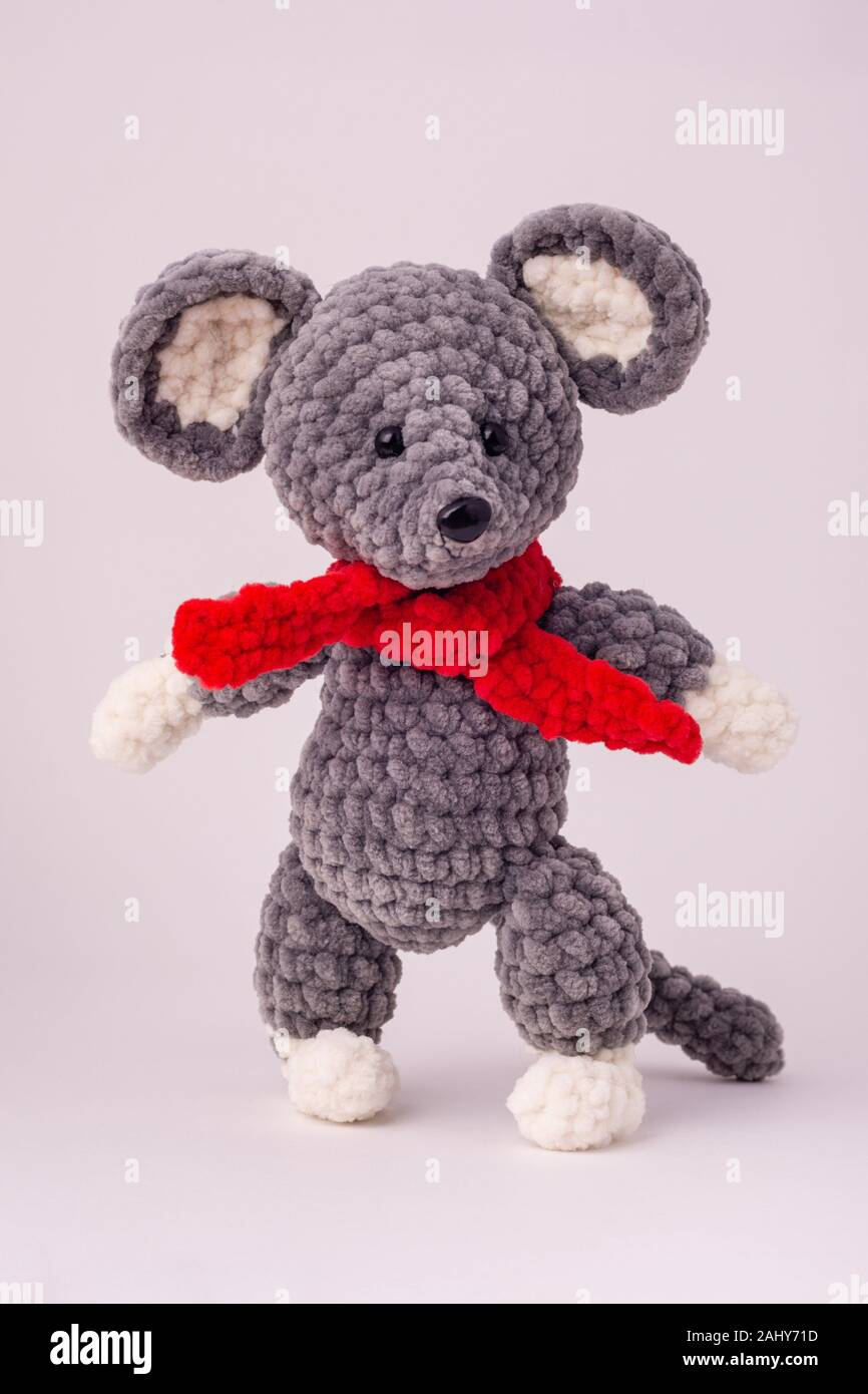Funny knitted teddy mouse, white background. Stock Photo