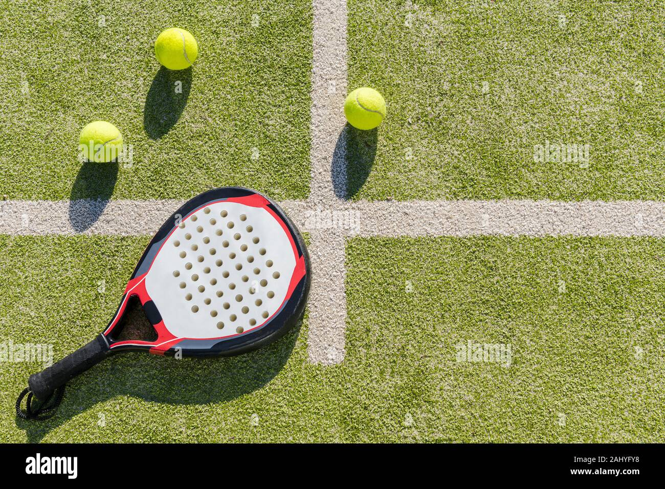 top view of a paddle tennis racket and balls on court of artificial turf, indoor sports concept and sporty lifestyle Stock Photo