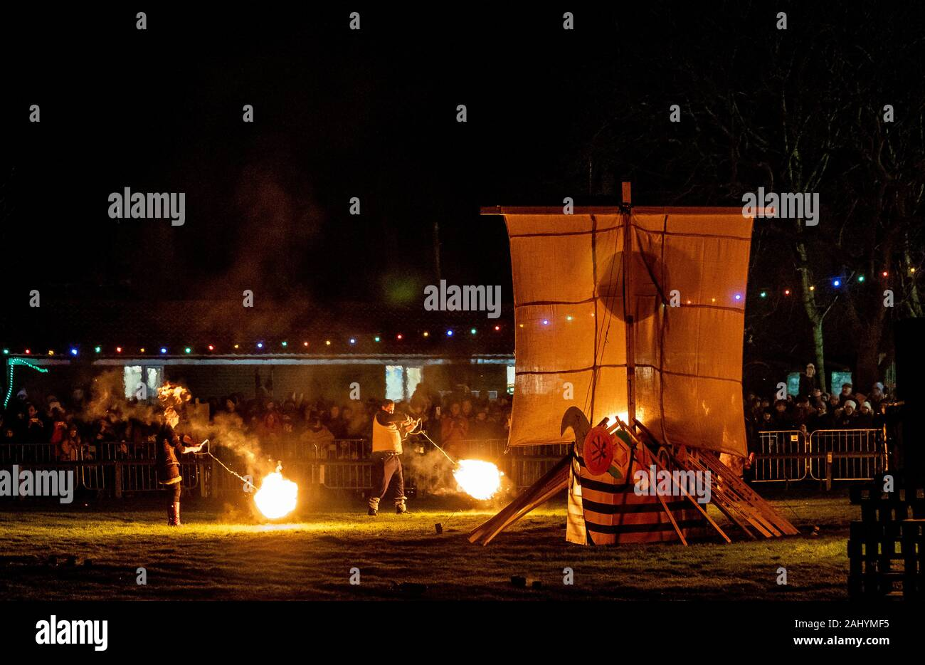 Flamborough Fire Festival. New Year's Eve 2019 celebrating the village connection with Viking History. Featuring the Flamborough Fireballs, Torchlit Procession and burning of a Viking Longboat on the village green. Stock Photo