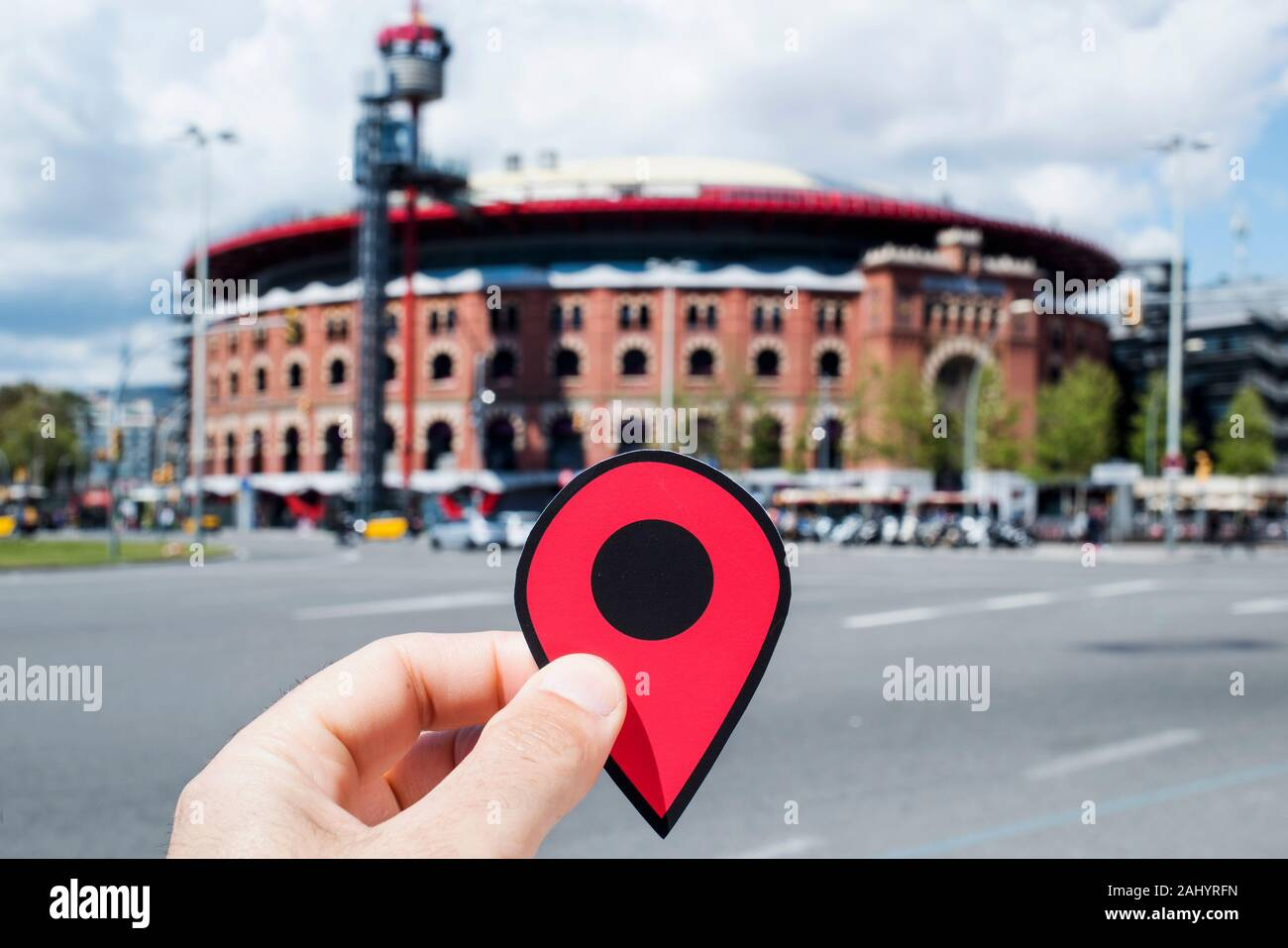 BARCELONA, SPAIN - APRIL 12, 2018: Closeup of the hand of a young caucasian man with a red marker at the Arenas de Barcelona, an old bullring that is Stock Photo