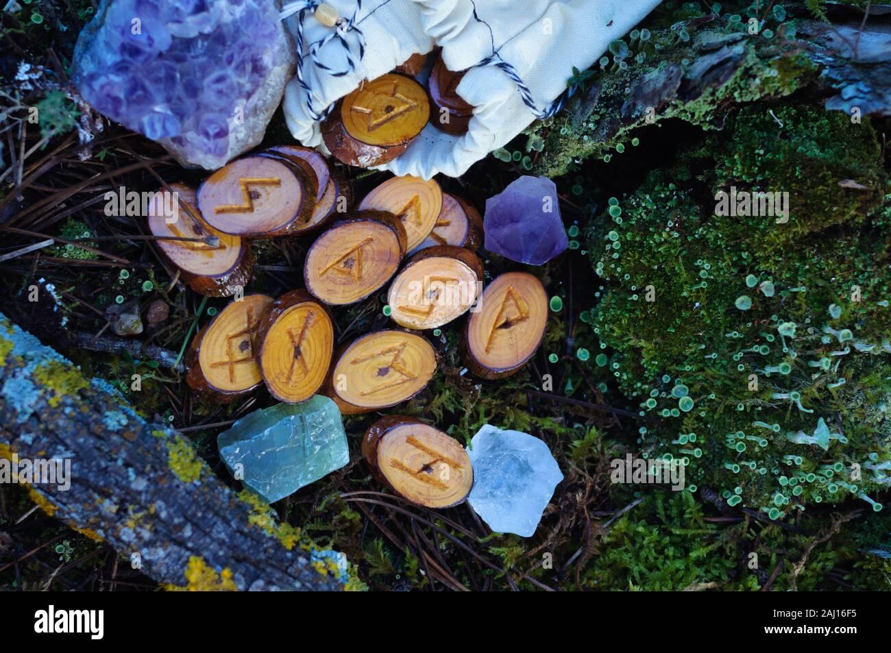 Wooden Homemade Runes Scattered On The Green Grass Moss Stock