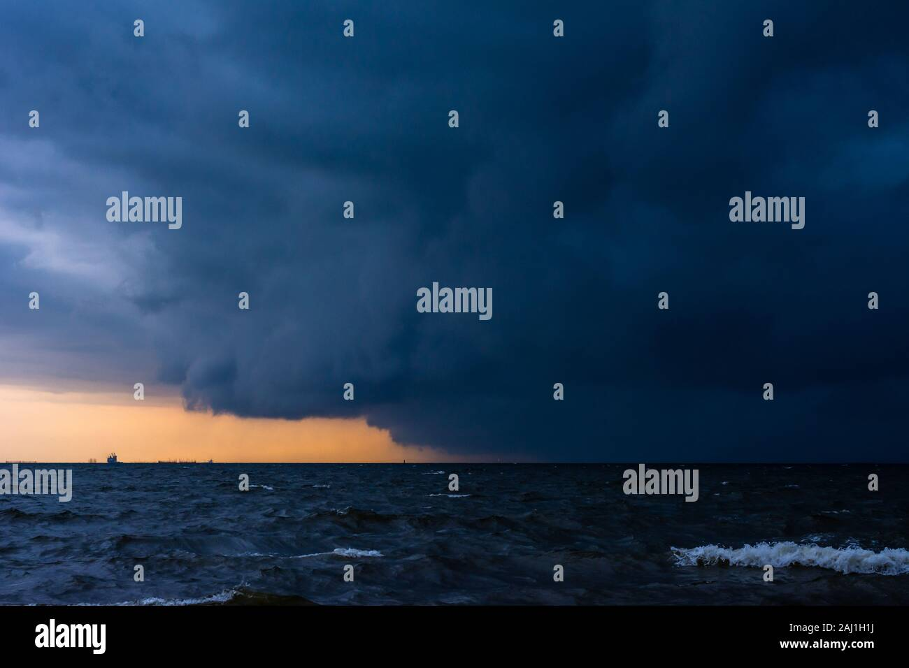 Approaching storm cloud with rain over the sea. Stock Photo