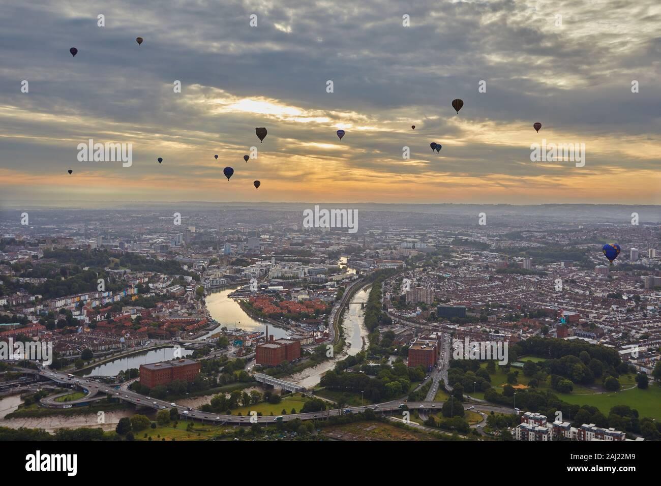 Hot-air balloons flying over the city of Bristol during the Bristol International Balloon Fiesta, Bristol, England, United Kingdom, Europe Stock Photo
