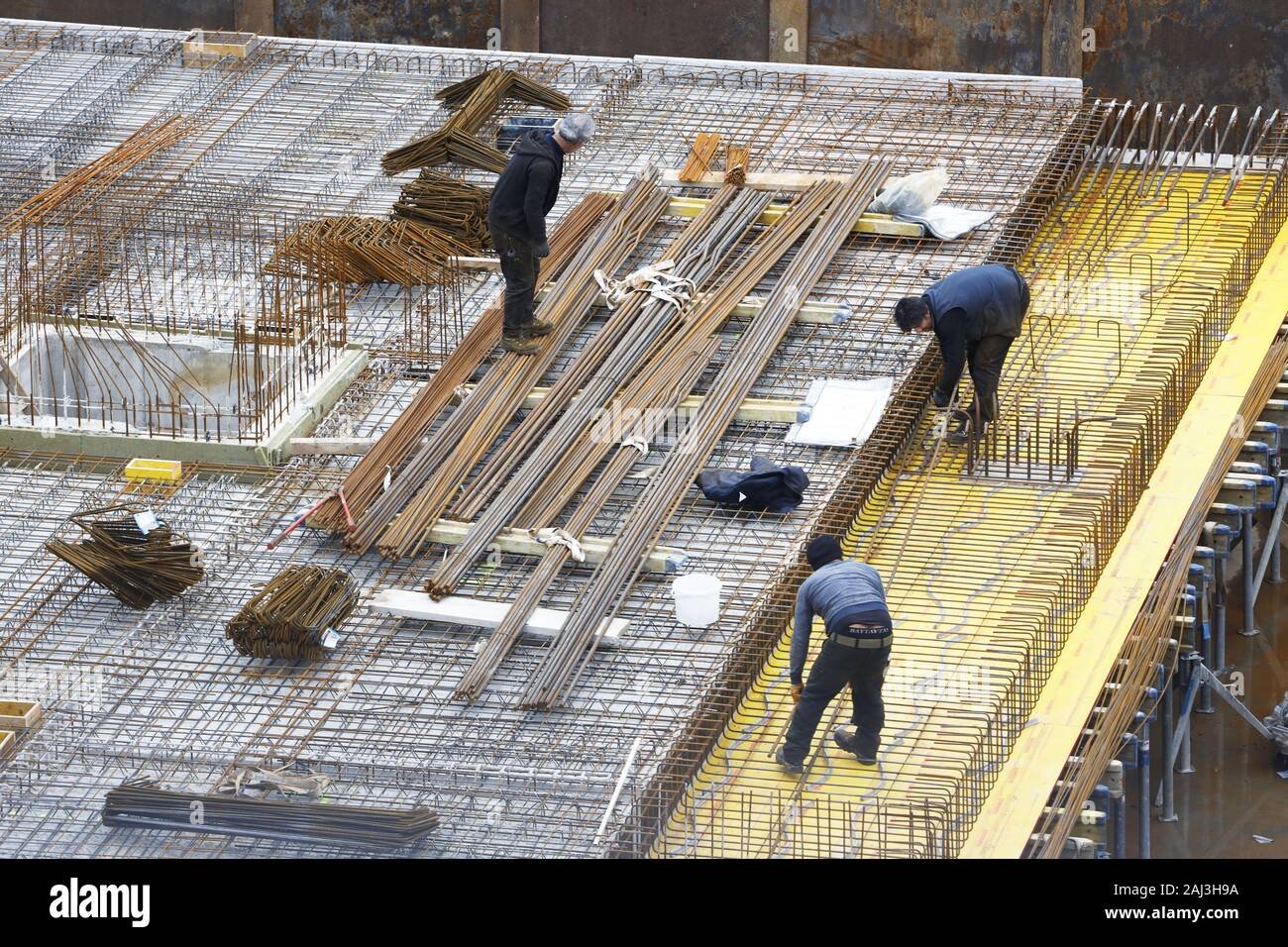 Construction site, reinforced concrete rebar, for a building ceiling, are being assembled, Stock Photo