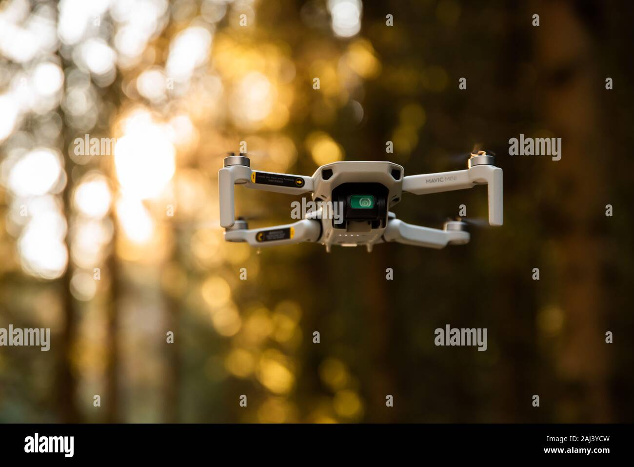 Graz Austria 02 01 2020 Close Up Shoot Of A Dji Quadcopter Drone Mavic Mini 249g Drone Flying In Sunny Forest Dji Is The Market Leader In Drones Stock Photo Alamy