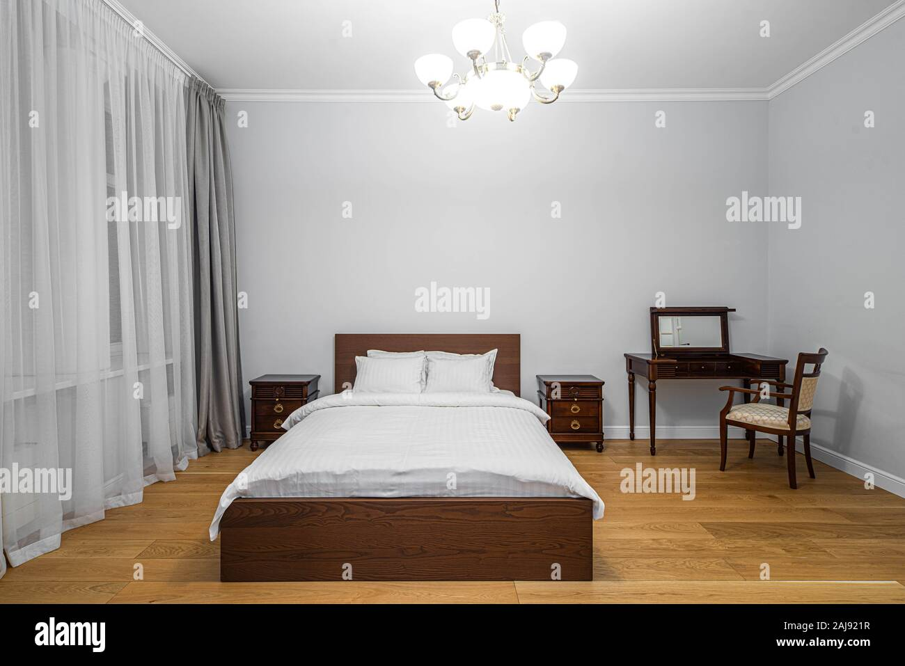 Modern Interior Of Bedroom Front View Of The King Size Bed Wooden Furniture Window And Curtain Stock Photo Alamy