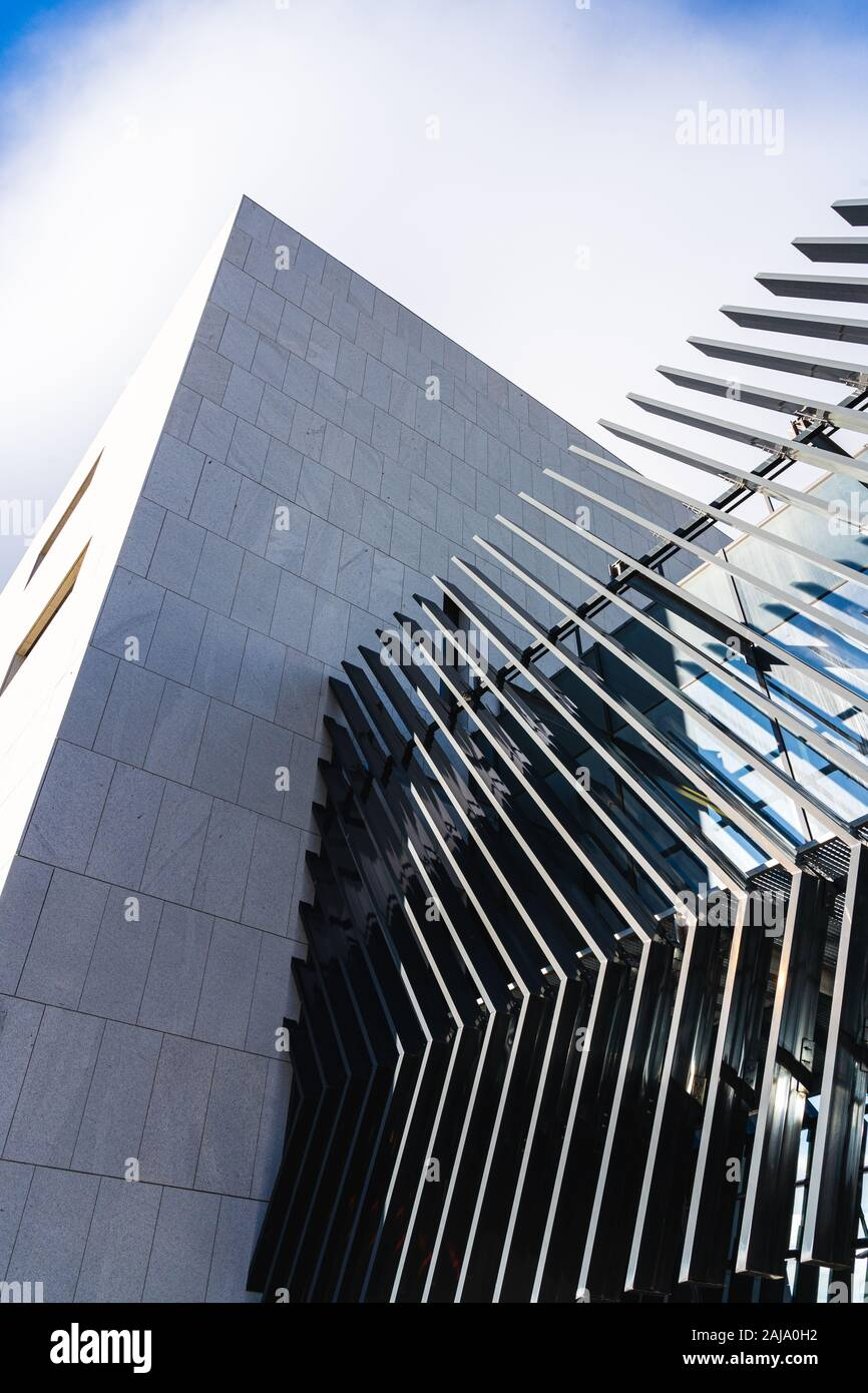 Angled parallel lines on the facade of a modern architecture building Stock Photo