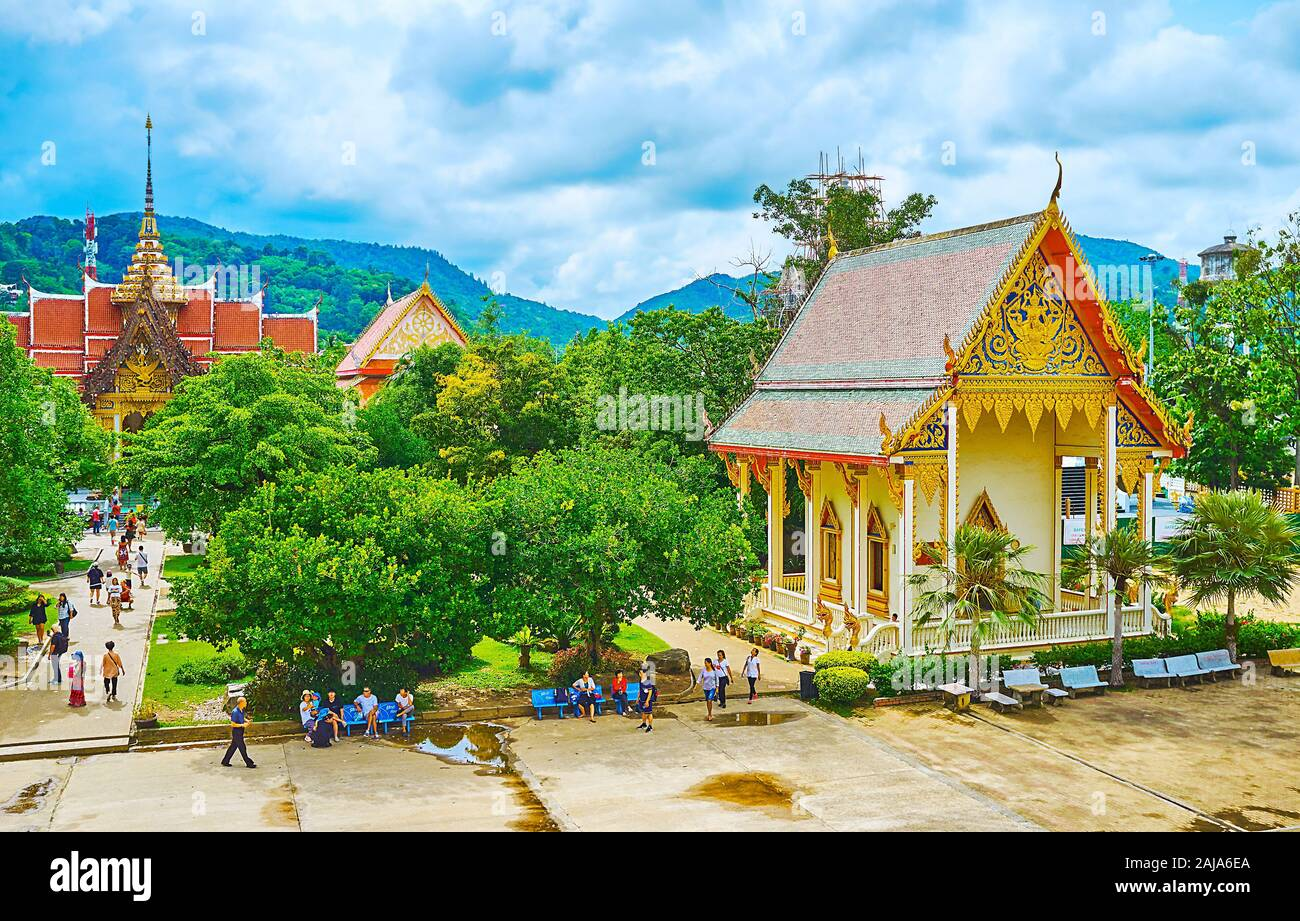 CHALONG, THAILAND - APRIL 30, 2019: Observe the grounds of Wat Chalong from the top floors of its Pagoda - the shrines and Ubosot of the complex are s Stock Photo