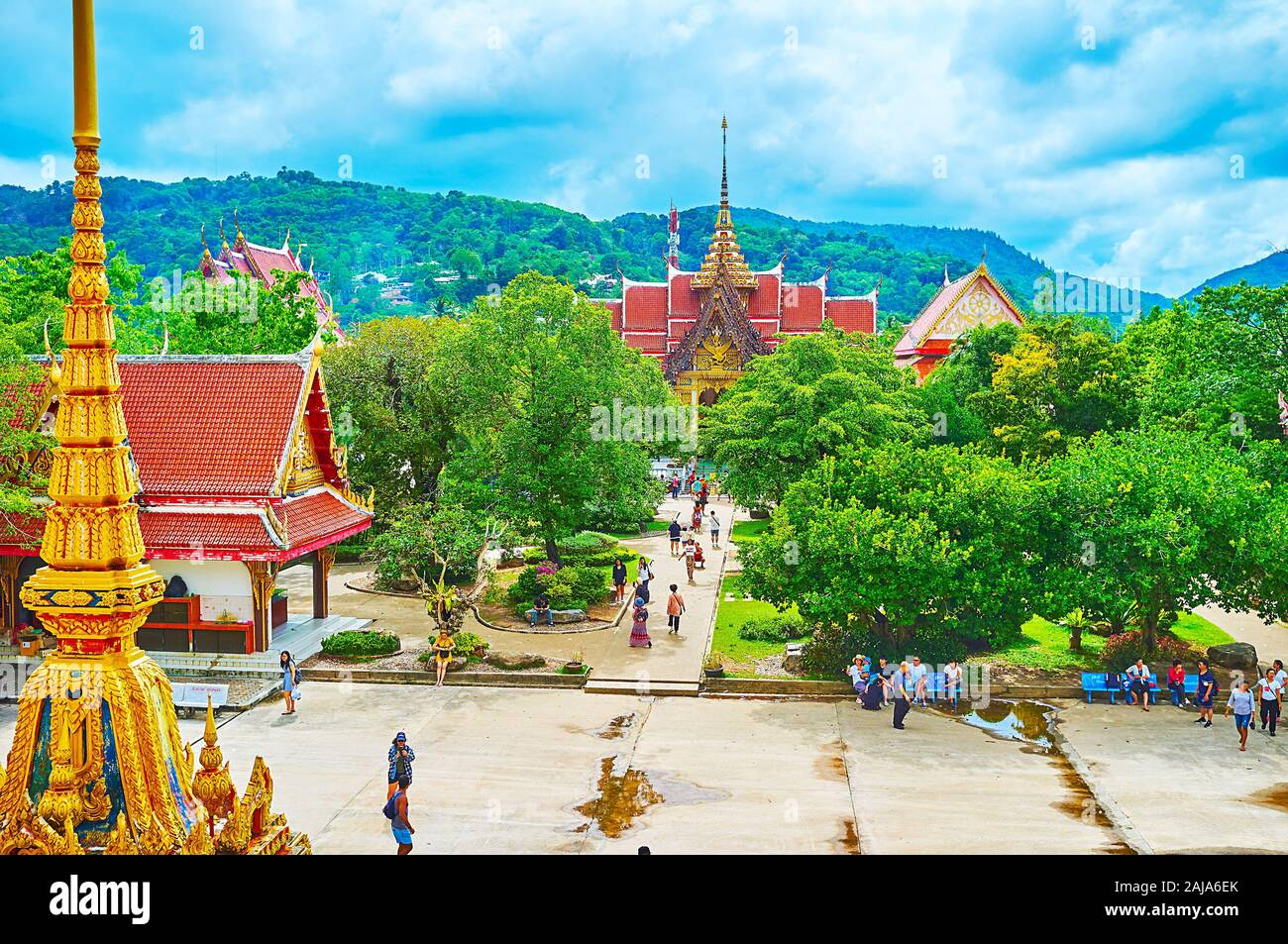 CHALONG, THAILAND - APRIL 30, 2019: Wat Chalong temple complex consists of shrines, pavilions and chedis, situated in lush tropical garden, on April 3 Stock Photo