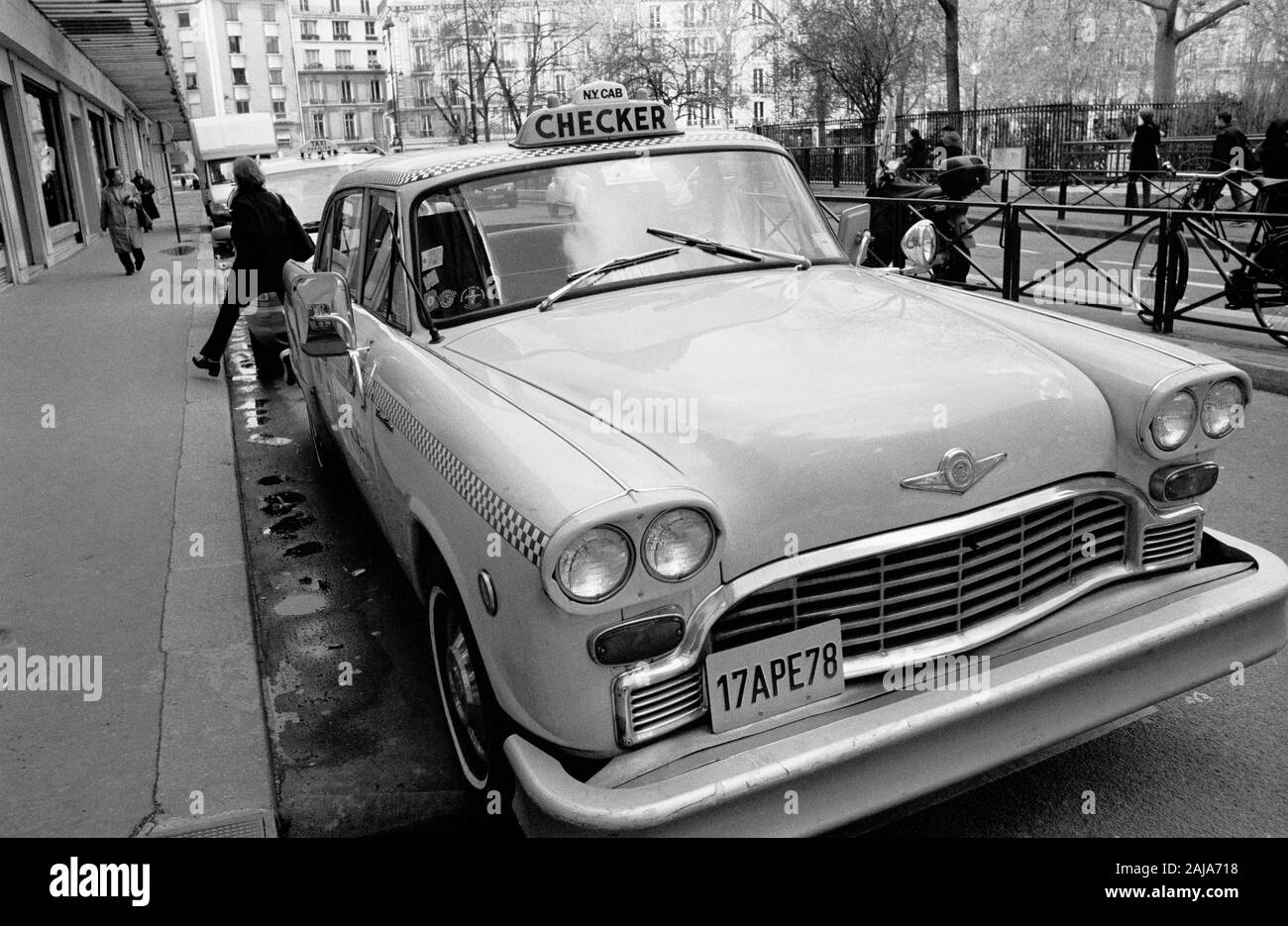 NEW YORK CAB IN PARIS STREET - CHECKER MOTORS CORPORATION - ICONIC AMERICAN TAXI - CHECKER CAB - PARIS CAR - STREET CAR PHOTOGRAPHY - SILVER IMAGE © Frédéric BEAUMONT Stock Photo