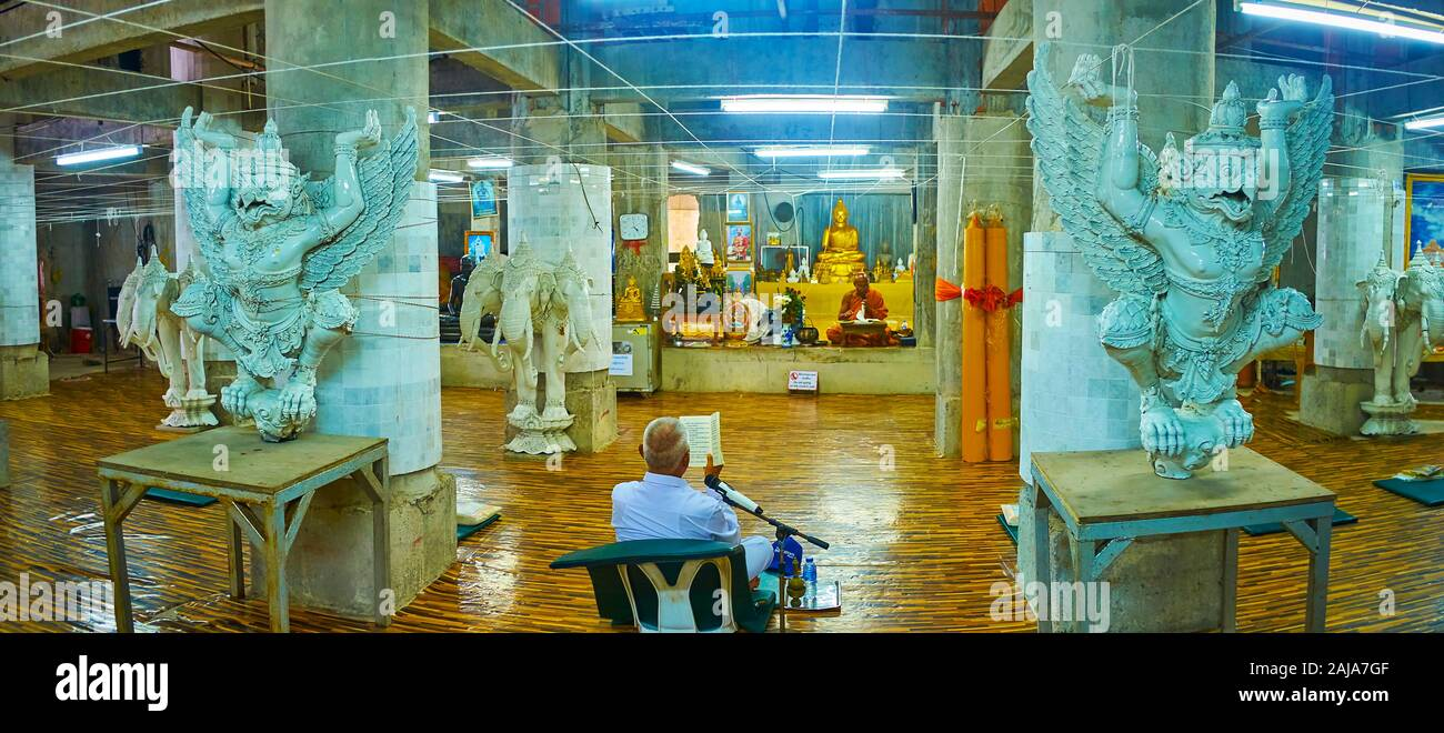 CHALONG, THAILAND - APRIL 30, 2019: Panoramic interior of the temple under Big Buddha statue with large sculptures of Garuda, three-headed elephants a Stock Photo