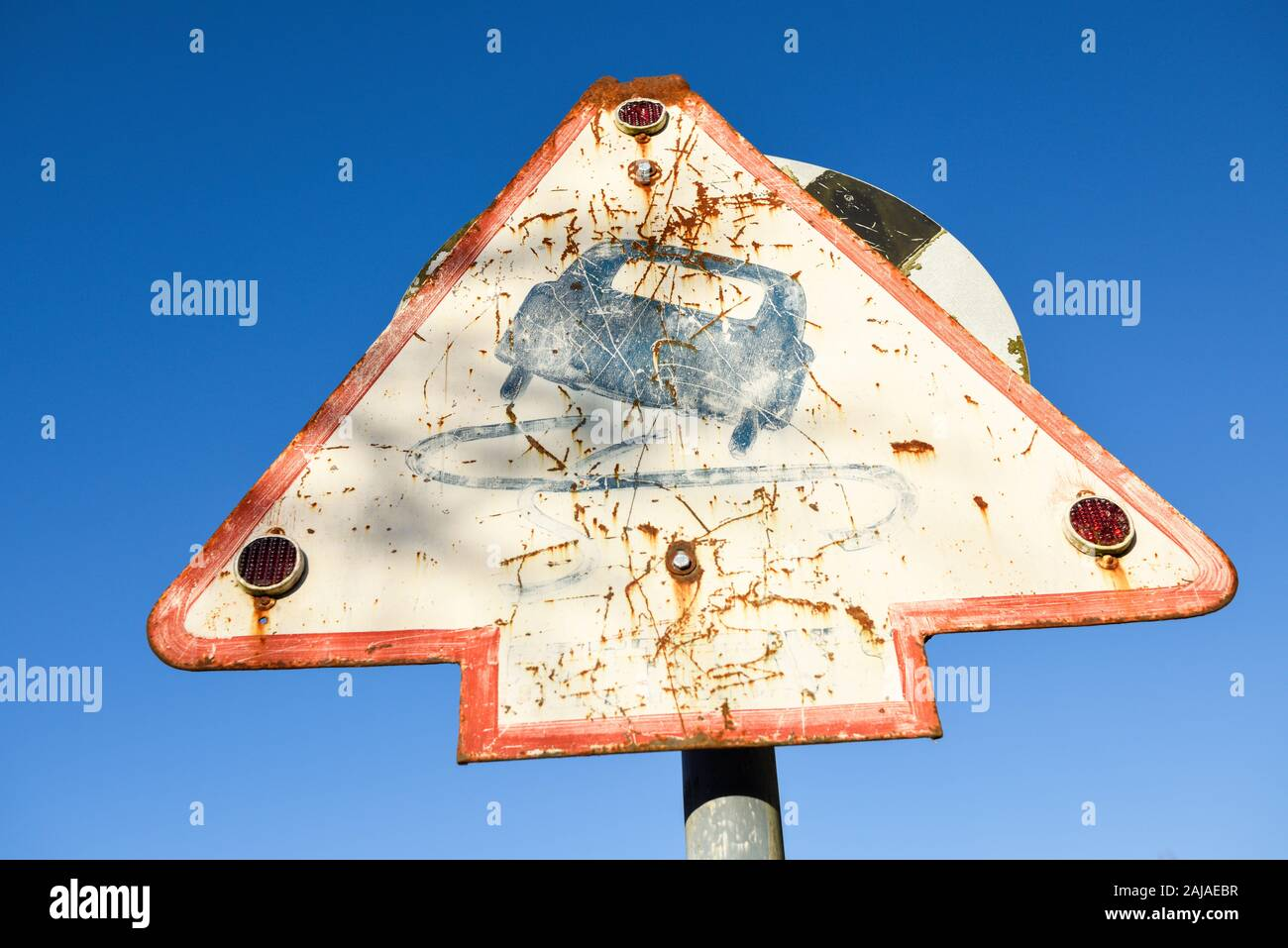 Vintage Traffic Road Signs Triangular Warning Sign Slippery Surface. Stock Photo