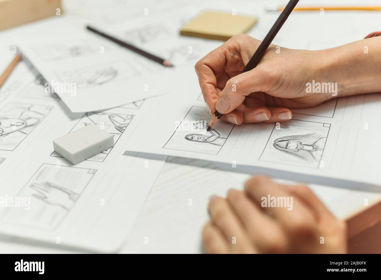 Woman's hand draws a storyboard for a film or cartoon. Stock Photo
