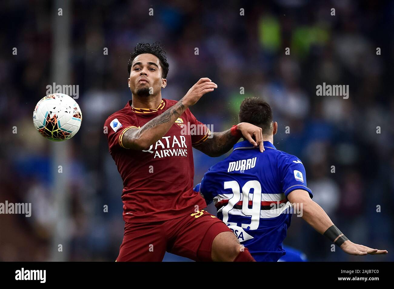 Genoa, Italy - 20 October, 2019: Justin Kluivert (L) of AS Roma competes for the ball with Nicola Murru of UC Sampdoria during the Serie A football match between UC Sampdoria and AS Roma. The match ended in a 0-0 tie. Credit: Nicolò Campo/Alamy Live News Stock Photo