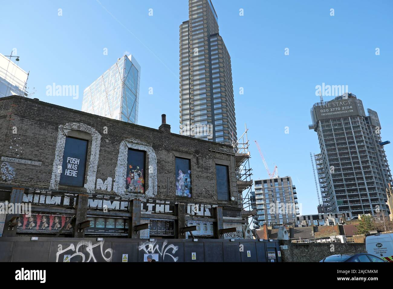 View of old new buildings Principal Place and The Stage high rise residential tower under construction from Commercial Street London E1  KATHY DEWITT Stock Photo