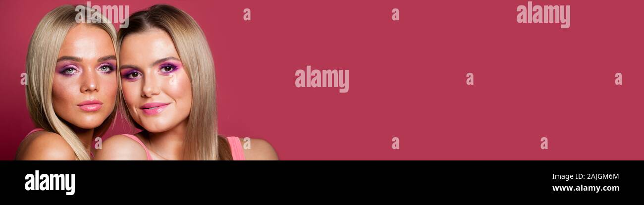 Beautiful Women Models With Fashion Makeup On Pink Banner Background Stock Photo Alamy