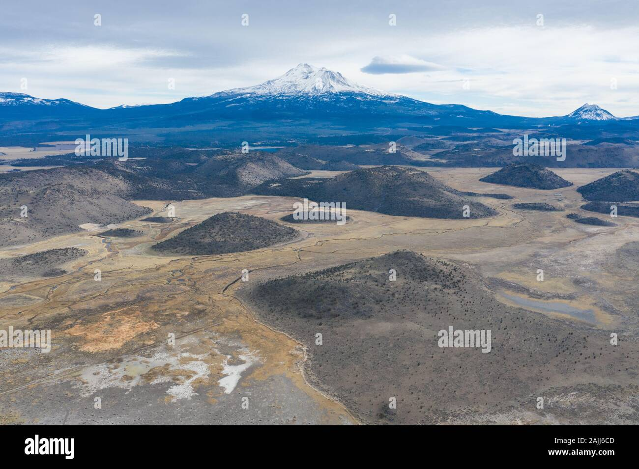 Mount Shasta in northern California is among the largest and most active volcanoes in the Cascade Range. The peak reaches 14,160 feet in height. Stock Photo