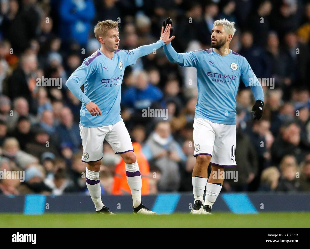 Manchester City's Oleksandr Zinchenko (left) celebrates scoring his side's  first goal of the game with team-mate Sergio Aguero during the FA Cup third  round match at the Etihad Stadium, Manchester Stock Photo -