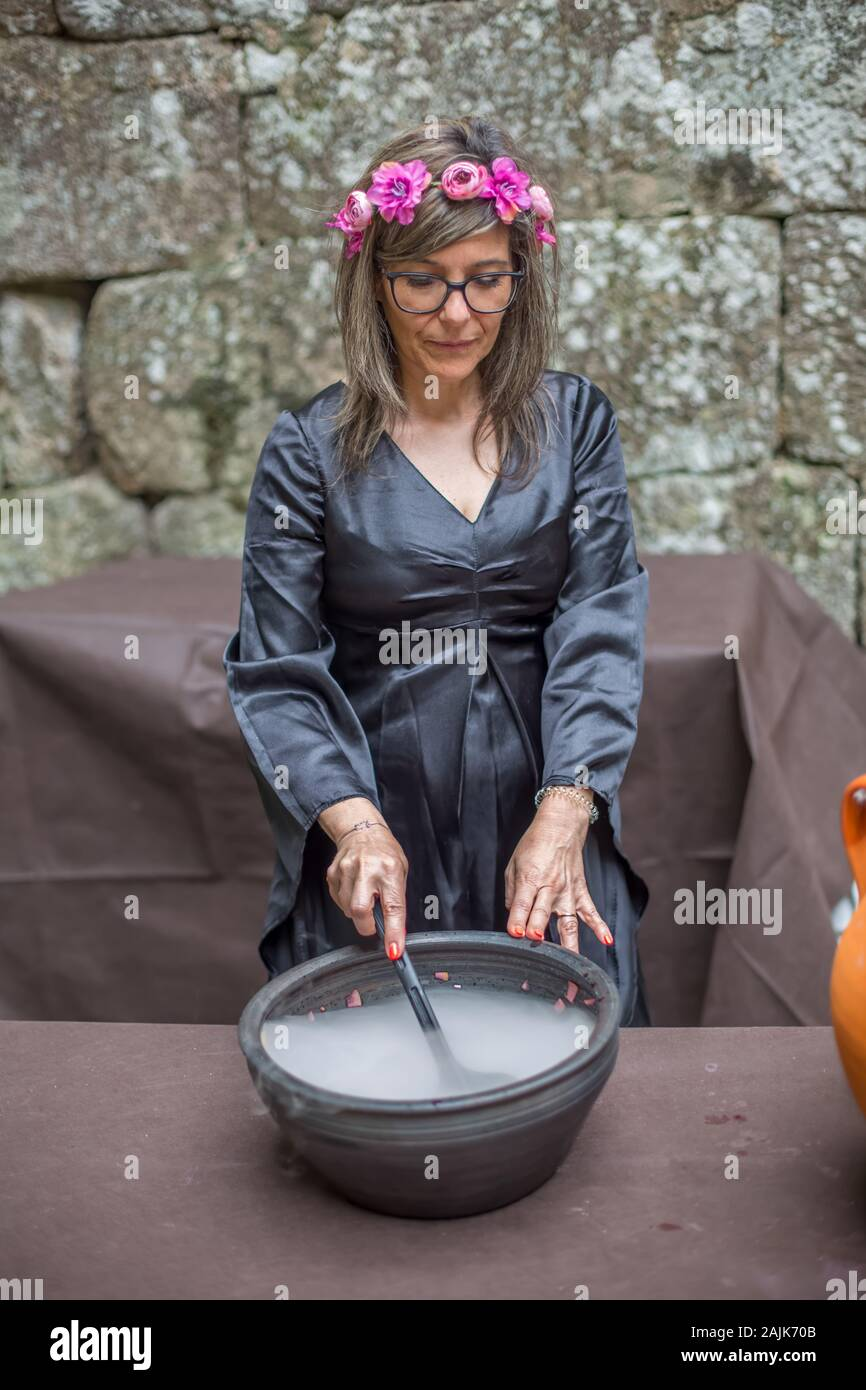Vouzela Portugal 07 07 2019 View Of A Witch Performing In Medieval Market Actress Dressed In Witch S Robes And Cooking Magic Potion Stock Photo Alamy