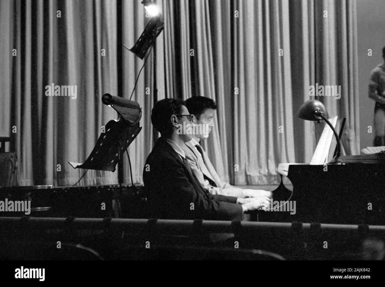John Cage and David Tudor in performance in New York City, 1957, probably performing Winter Music. The exact date and venue are unknown. Stock Photo