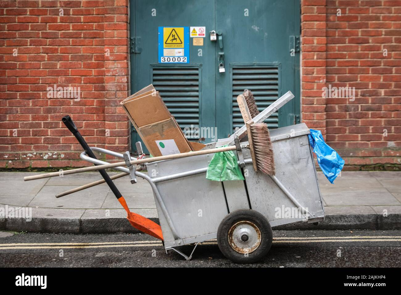 Dust card, council street cleaning trolley cart with brushes, exterior in Central London, UK Stock Photo