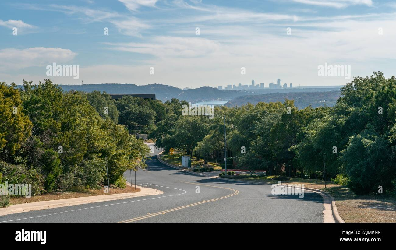 View of Road with Bike Lane with Downtown Austin Skyline in the background in a Sunny Day Stock Photo