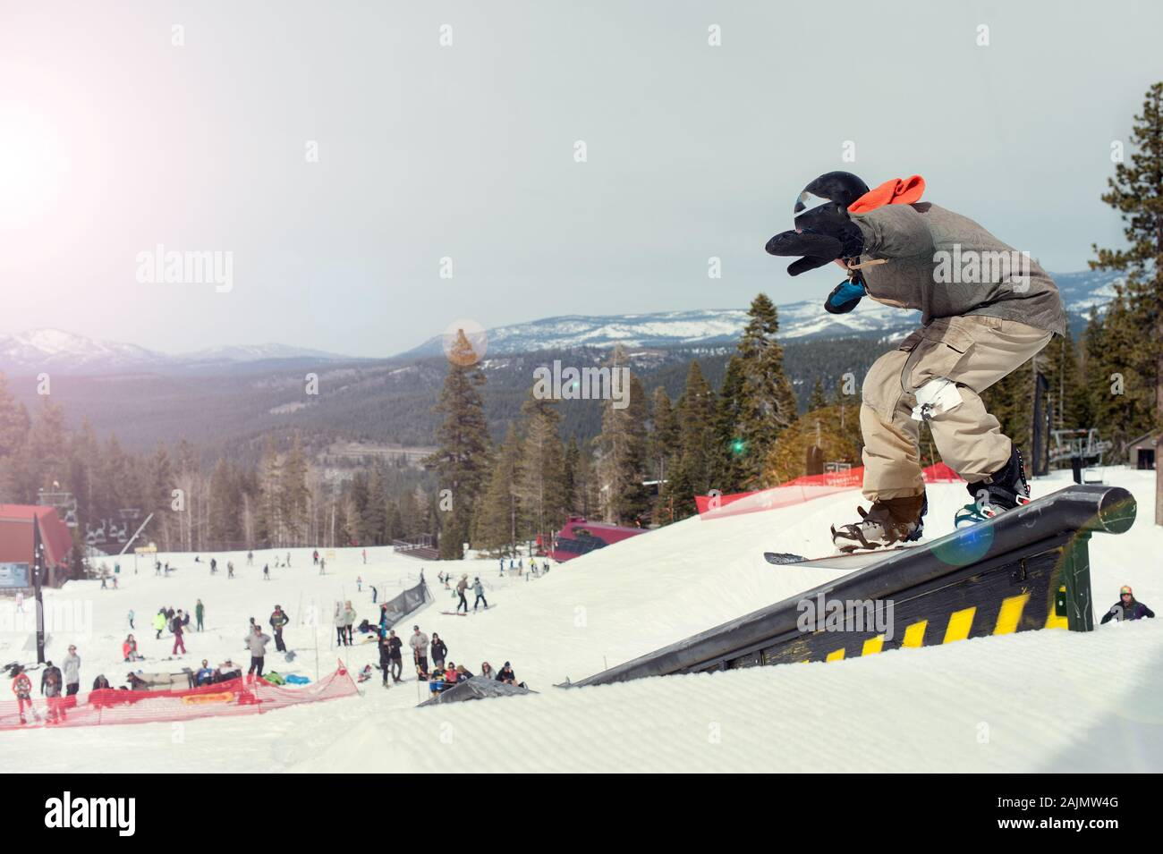 snowboarder on a rail in lake tahoe ca Stock Photo
