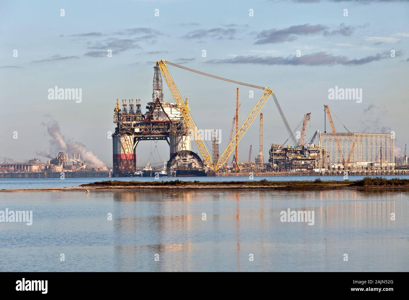 Construction of 'Big Foot' deepwater oil & gas platform nearing completion, swing booms, at dawn,  Ingleside Bay. Stock Photo