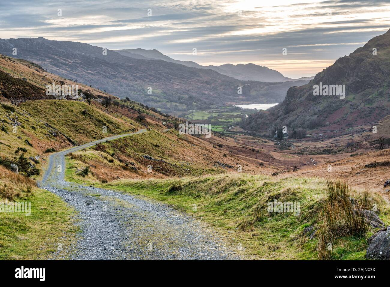 A rural mountain road in Snowdonia National Park in Wales over looking Llyn Gwynant Lake Stock Photo