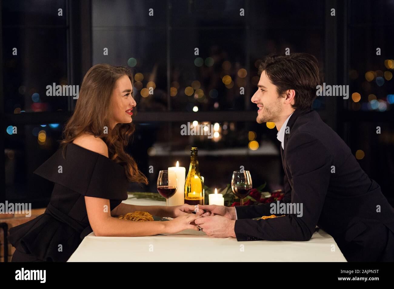 Romantic Date Beautiful Young Couple Dining In Luxury Restaurant Side View Stock Photo Alamy