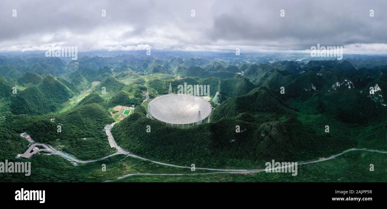 """(200105) -- BEIJING, Jan. 5, 2020 (Xinhua) -- Aerial photo taken on Aug. 27, 2019 shows China's Five-hundred-meter Aperture Spherical Radio Telescope (FAST), the world's largest single-dish radio telescope dubbed as the """"China Sky Eye"""", in Pingtang County, southwest China's Guizhou Province. (Xinhua/Ou Dongqu) Stock Photo"""