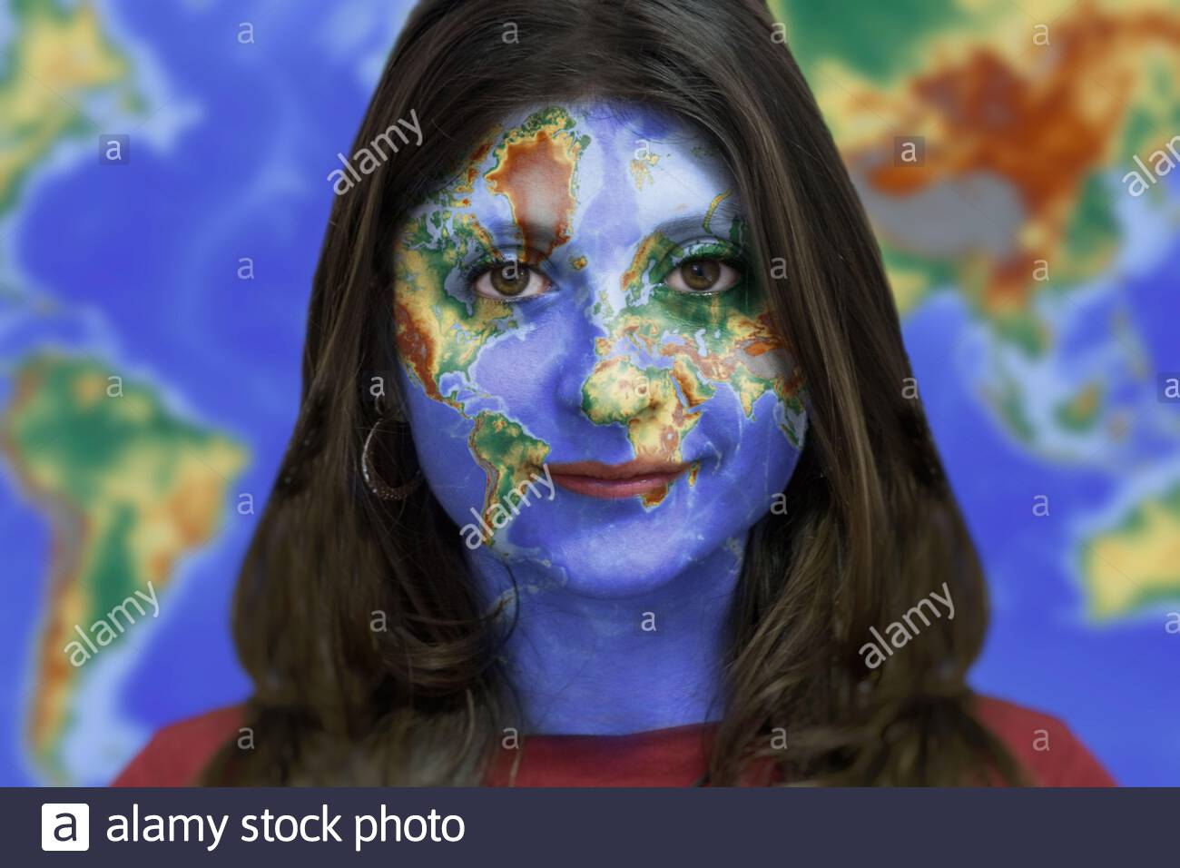 Girl With World Map On Her Face With World Map In The Background