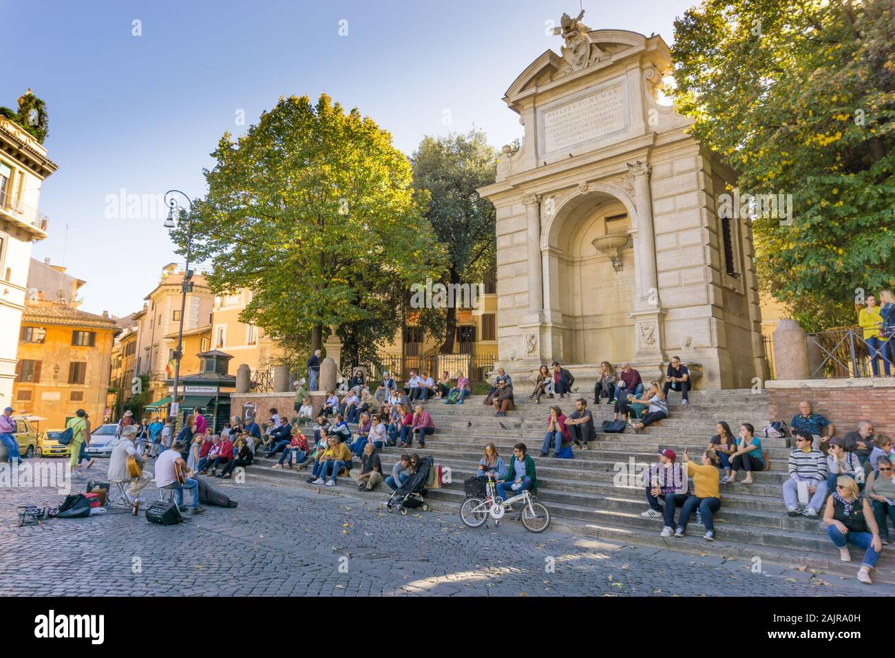 ROME, ITALY - OCTOBER 10, 2017: people are listening to an outdoor concert in Trilussa Square in Trastevere district in Rome, Italy Stock Photo