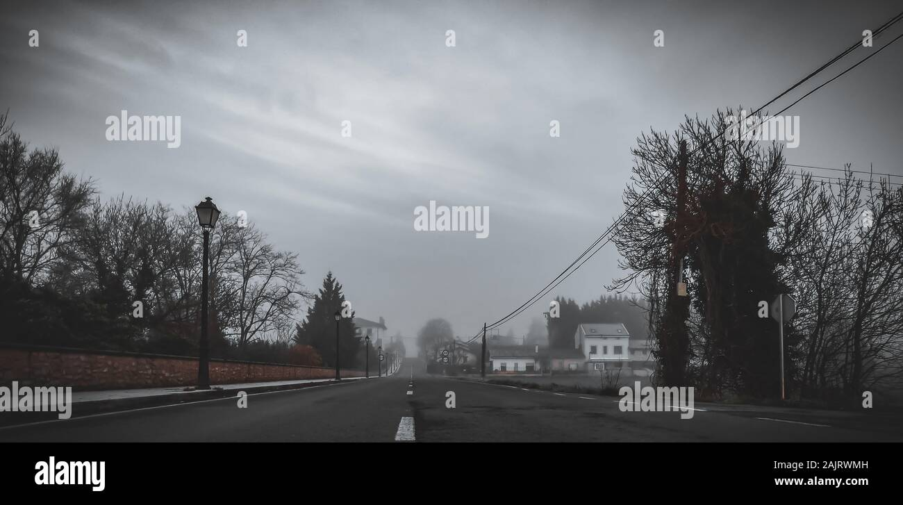 Foggy Town Seen From The Dark Road Stock Photo Alamy