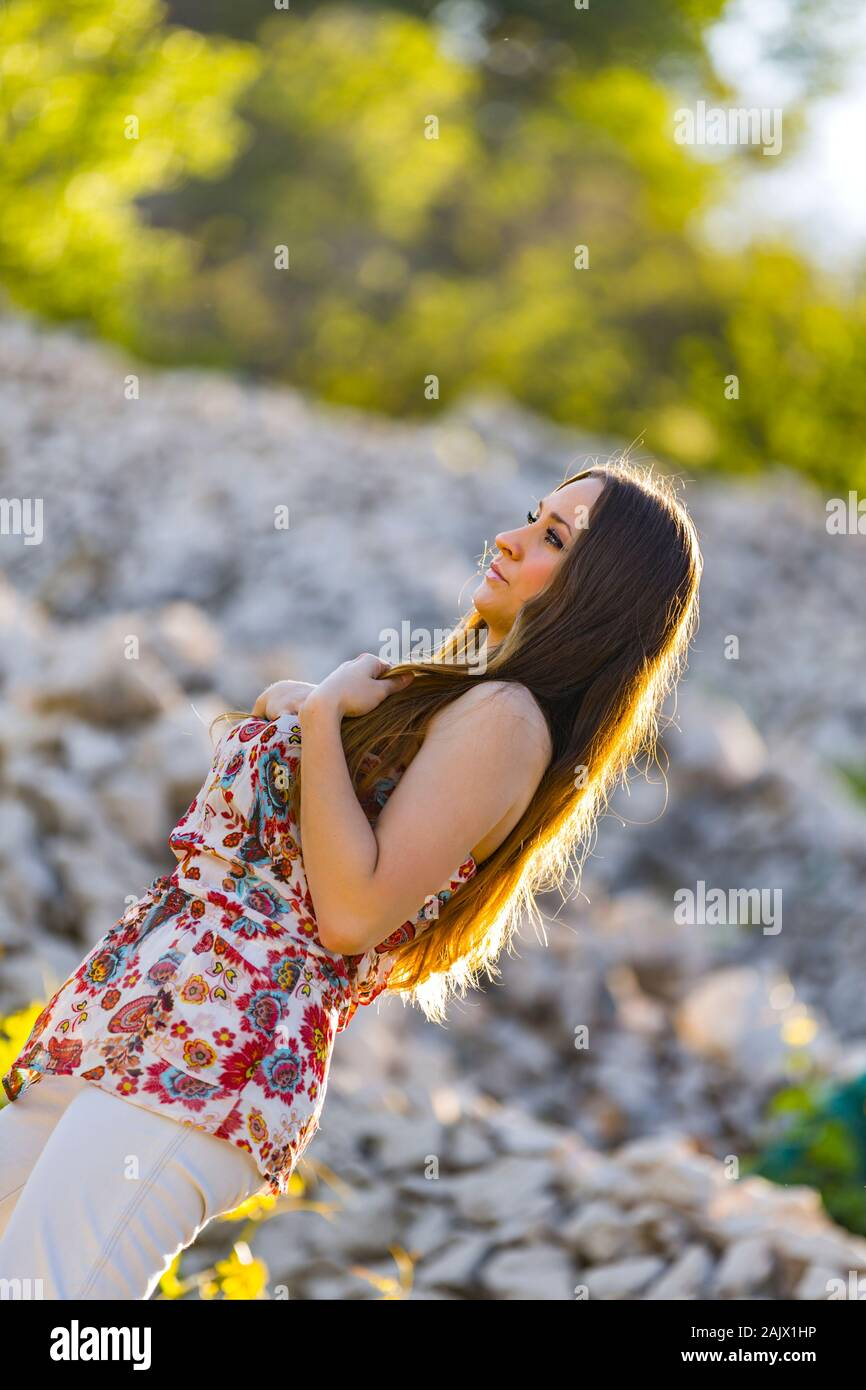 Standing isolated from background before field with stones and trees Stock Photo