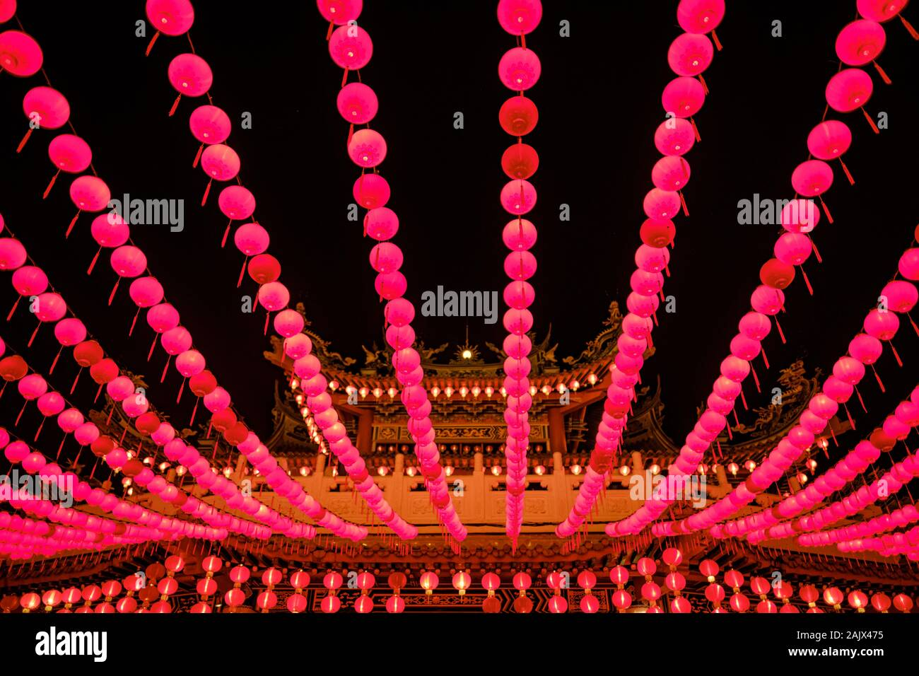 Red lanterns hanging in rows during chinese lunar new year in the night at Thean Hou Temple, Kuala Lumpur, Malaysia Stock Photo