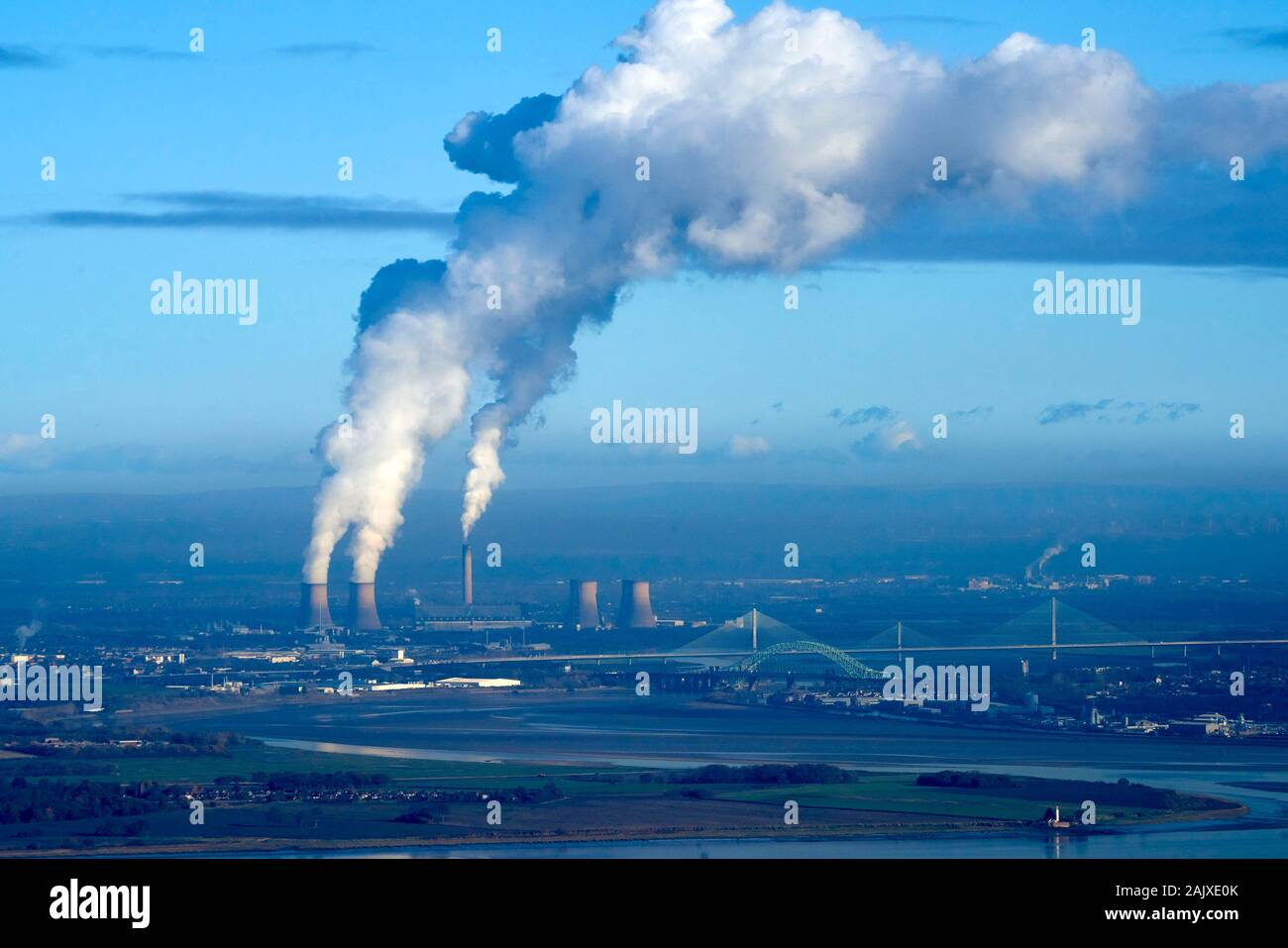 Polluting smoke drifting south in winter sun, from Fiddlers Ferry Coal Power Station, Merseyside, North West England, UK Stock Photo