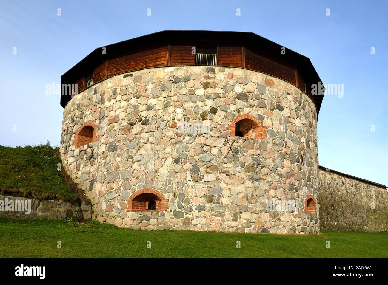 Medieval fortress on coast of famous lake Vanajavesi in old Hameenlinna, Finland. Round gun turret Stock Photo