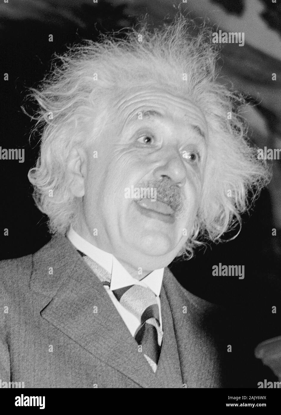 Vintage photo of theoretical physicist Albert Einstein (1879 – 1955) giving a speech at the Eighth American Scientific Congress in Washington DC in May 1940. Photo by Harris & Ewing. Stock Photo
