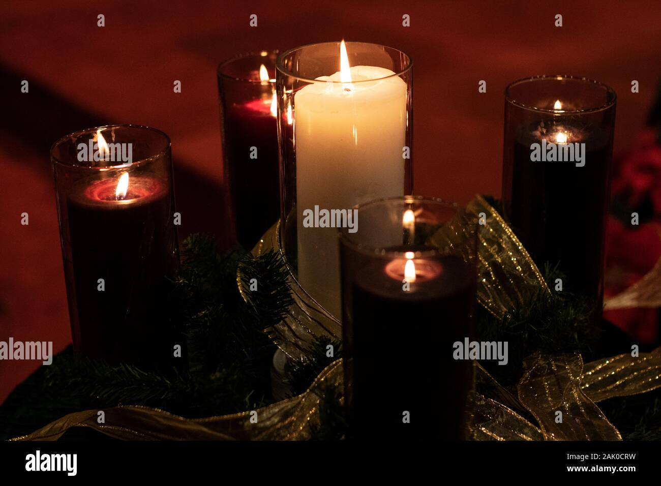 Purple Advent Candles And The White Christ Candle In The Center Burning In A Church On Christmas Eve Stock Photo Alamy