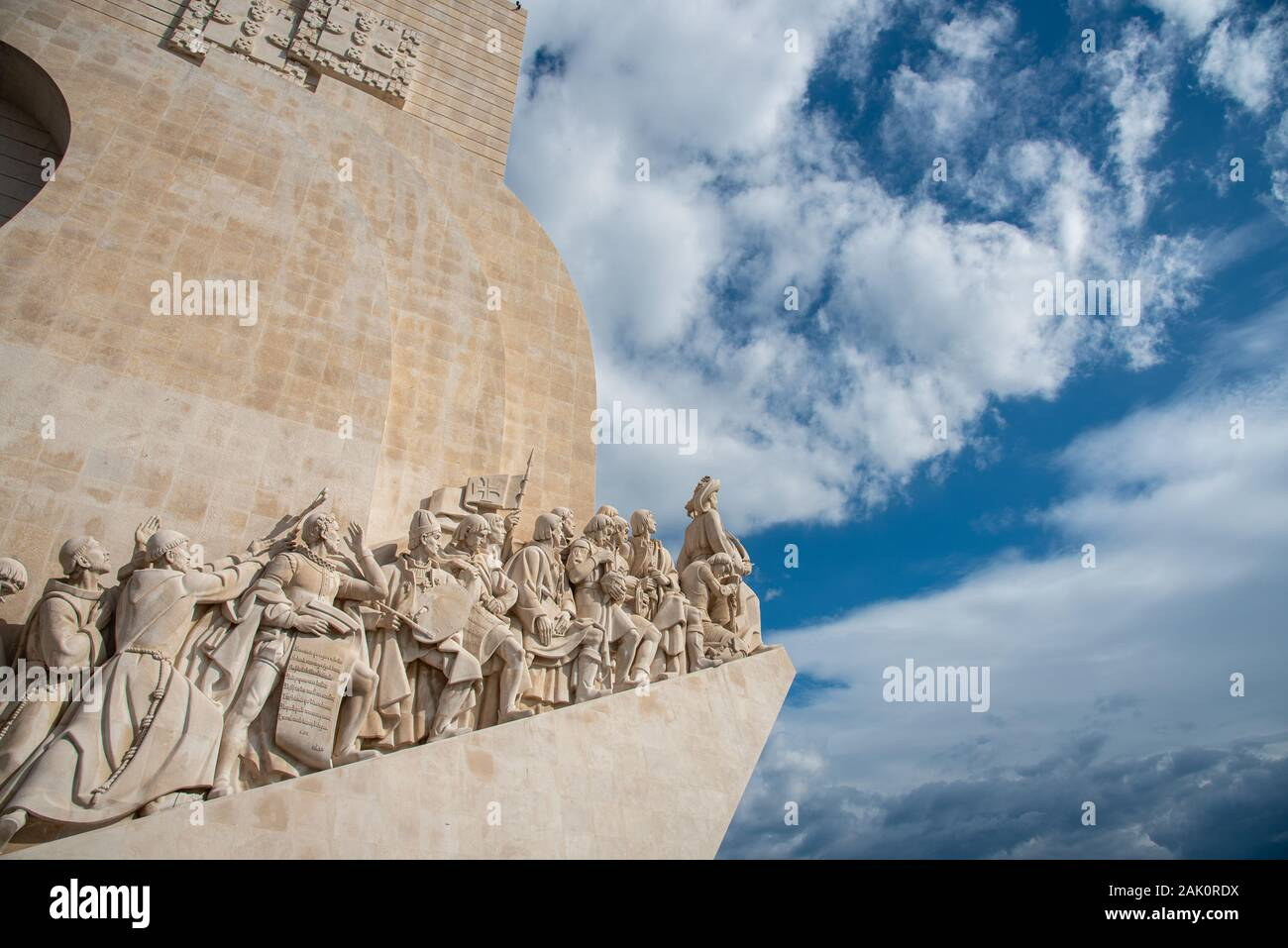 The Padrao dos Descobrimentos or Monument to the Discoveries against blue cloudy sky. Stock Photo