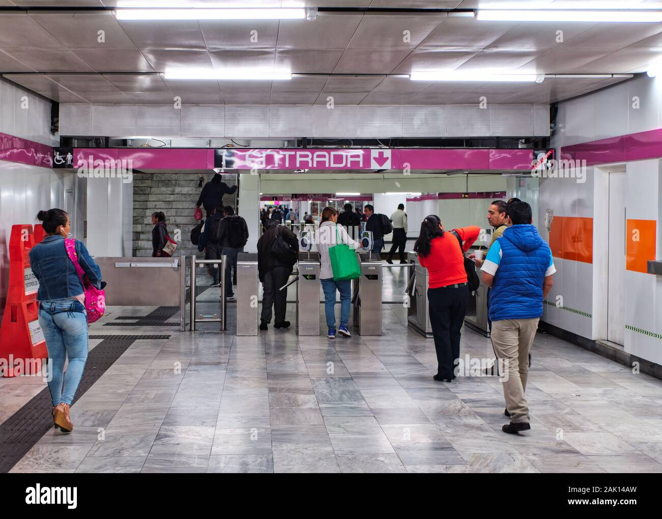 Sistema de Transporte Colectivo, Mexico City, October 16, 2019 - Entrance to Mexico City subway with people paying for the ticket using the rechargeable card. Stock Photo