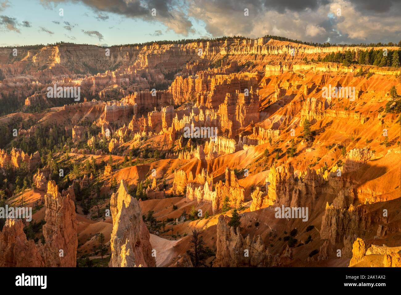 Sunrise light hits the amphitheater at the Bryce Canyon Stock Photo