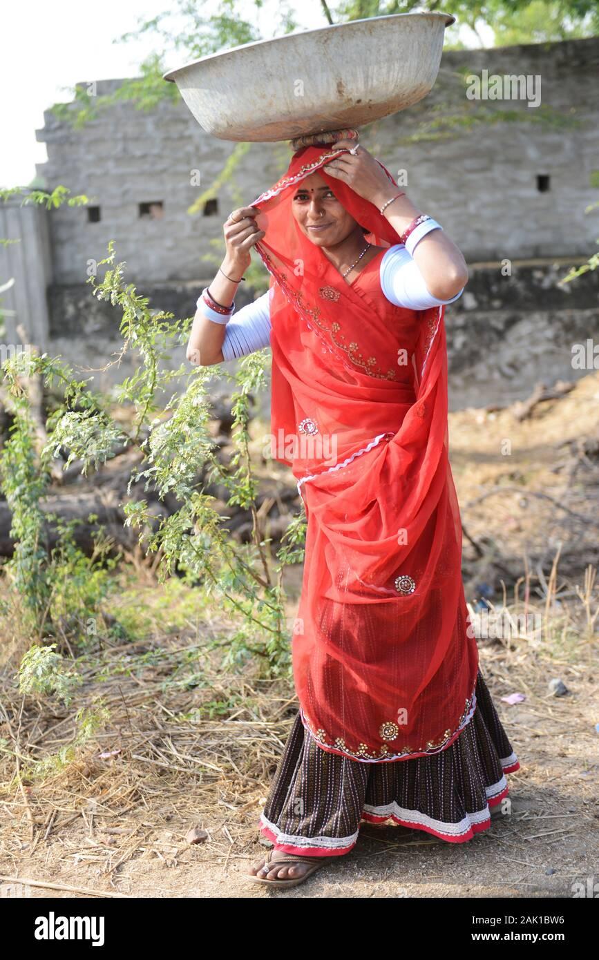 Rajasthani woman wearing Chuda ( traditional arm white bangles ). Stock Photo
