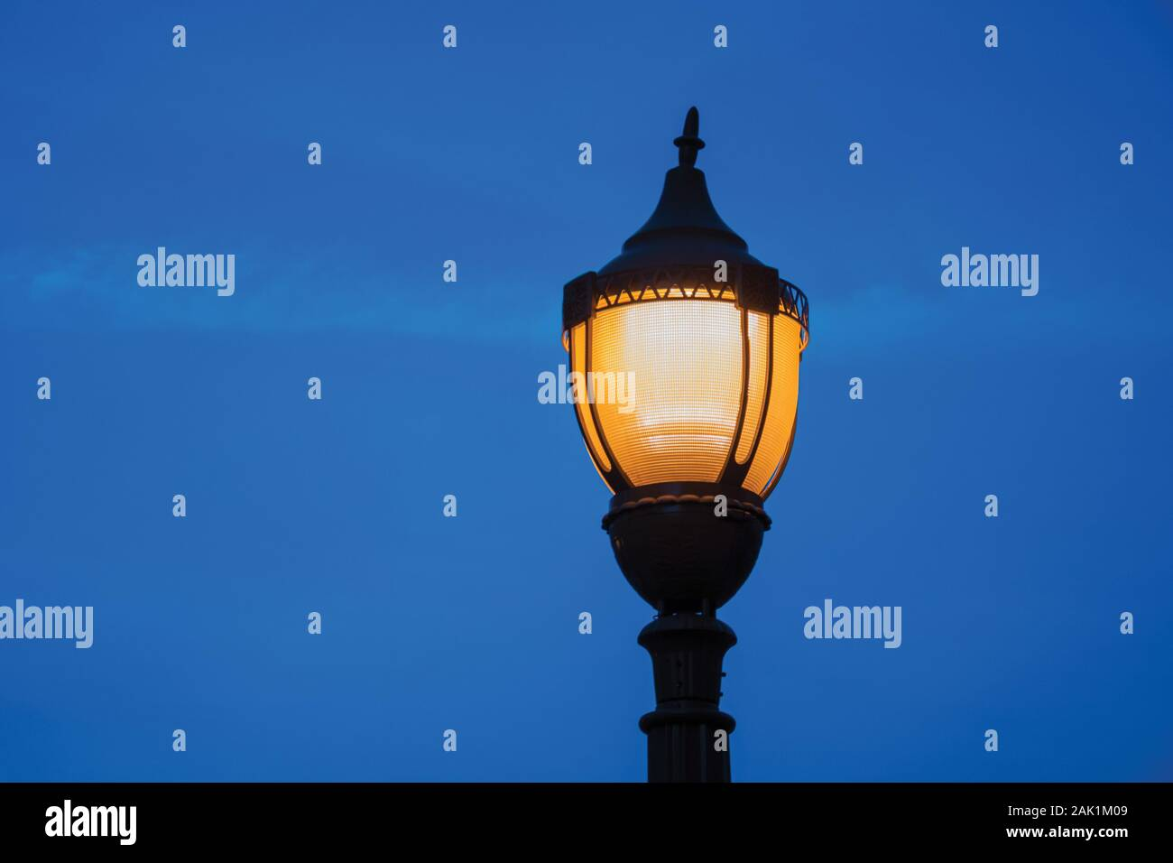 Detail of an old light post at nightfall with dark blue sky in Garibaldi. A wine producing country city in southern Brazil. Stock Photo