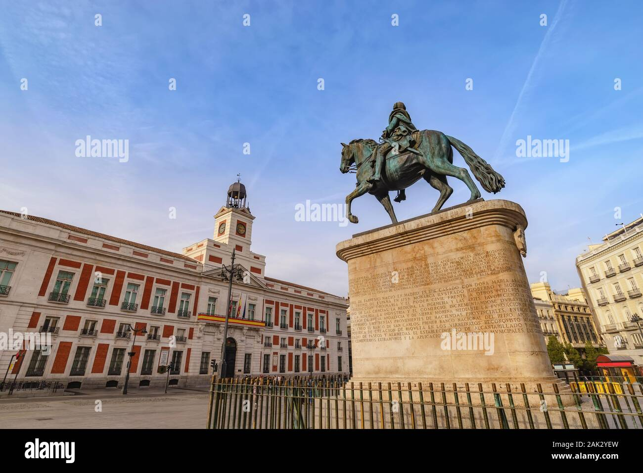 Madrid Spain, city skyline at Puerta del Sol and Clock Tower of Sun Gate with Equestrian Statue of Carlos III Stock Photo